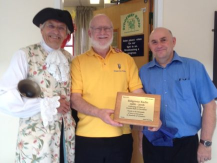 Photo of The President,Chairman and Robb Mott with commemorative plaque