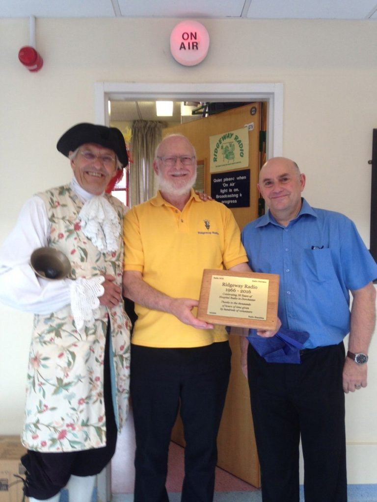 Photo of Alistair Chisholm, Andy Worth and Rob Mott with the Plaque
