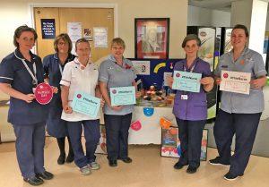 Nursing staff gather in Dorset County Hospital's Education Centre to celebrate Nurses' Day.